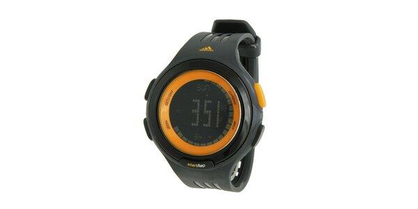 Černé sportovní digitální hodinky Adidas s oranžovými detaily
