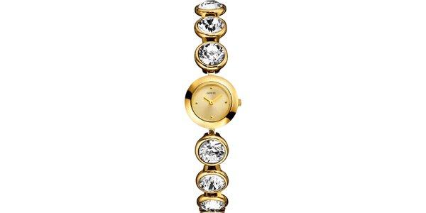 Dámské zlatě tónované hodinky s krystaly Guess
