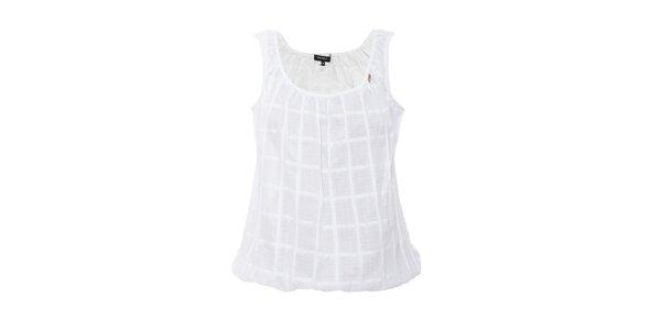Bílé volné tílko v romantickém stylu. Výrobek je volnějšího střihu.