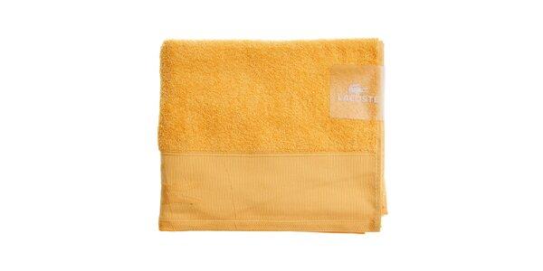 Větší oranžovožlutý ručník Lacoste