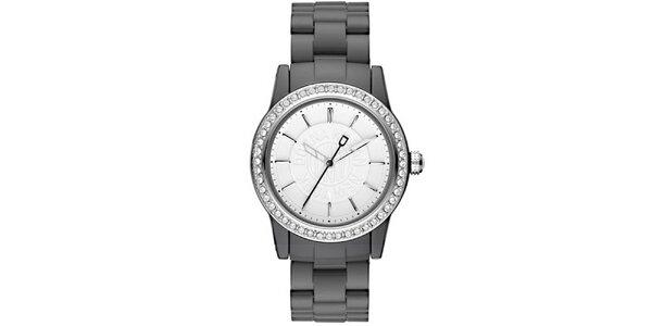 Dámské analogové hodinky s kamínky na lunetě DKNY