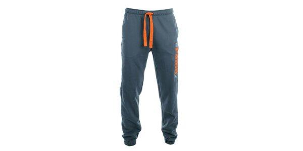 Pánské šedé teplákové kalhoty s oranžovými prvky Puma