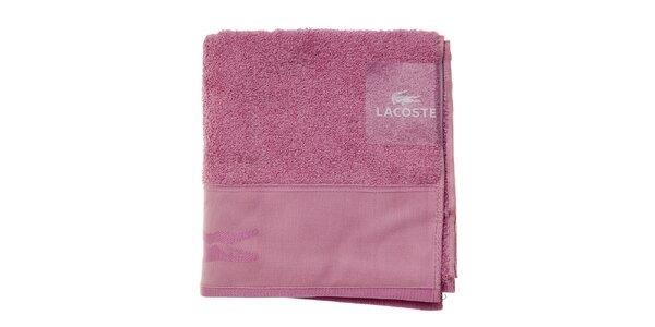 Sytě růžový ručník Lacoste