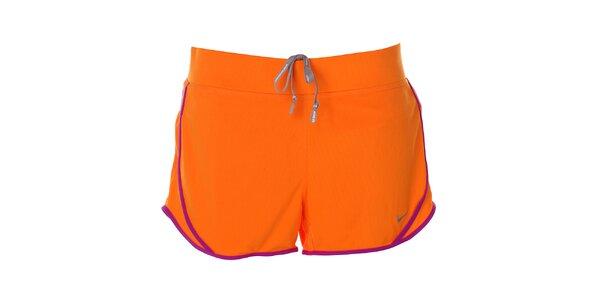 Dámské oranžové šortky s lemem Nike