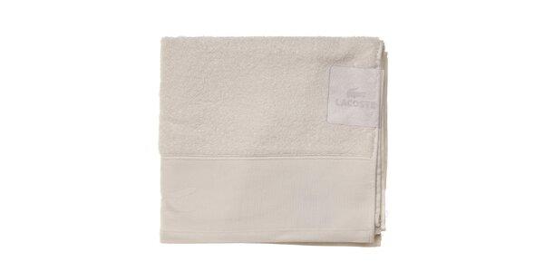 Větší sněhově bílý ručník Lacoste