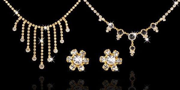 Krásné šperky ve zlatě a granátu