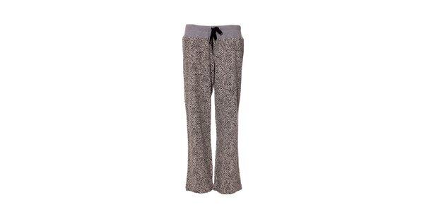 Kalhoty značky DKNY ve světle šedé barvě se vzorem