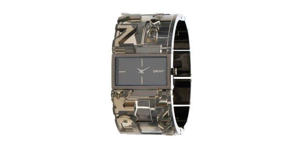 Dámské ocelové hodinky DKNY s transparentním řemínkem