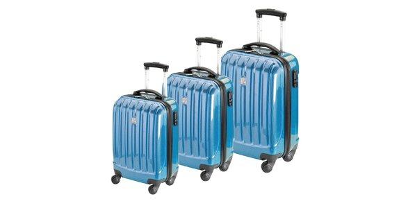 Set tří modrých lesklých pevných kufrů na kolečkách Valisa