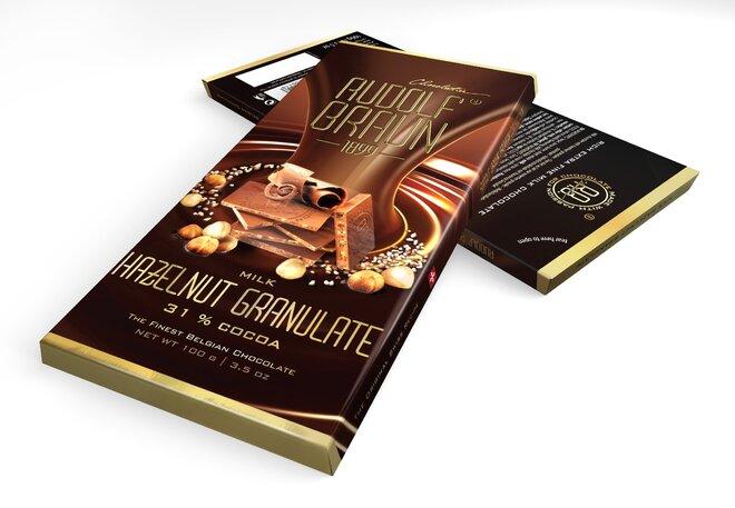 Mléčná čokoláda s kousky lískových oříšků, 31 % kakaa