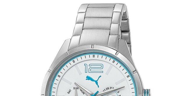 fb4c790a3cdf2 Dámské multifunkční stříbrné hodinky s tyrkysovými detaily Puma ...